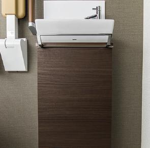 トイレ手洗い下に木調収納を設置